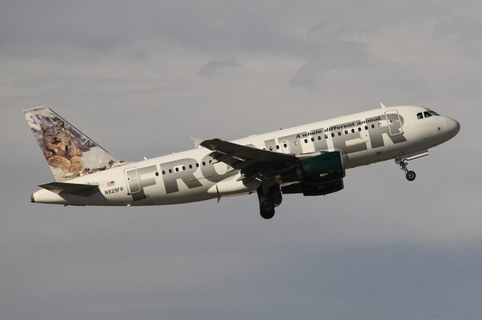 A Frontier Airlines plane in flight.