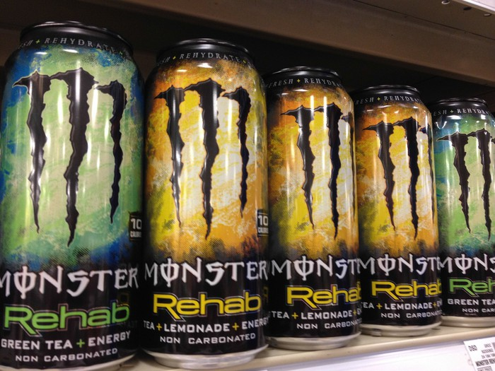 A row of Monster Energy cans