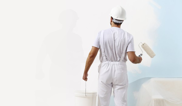 Getty Painter painting wall