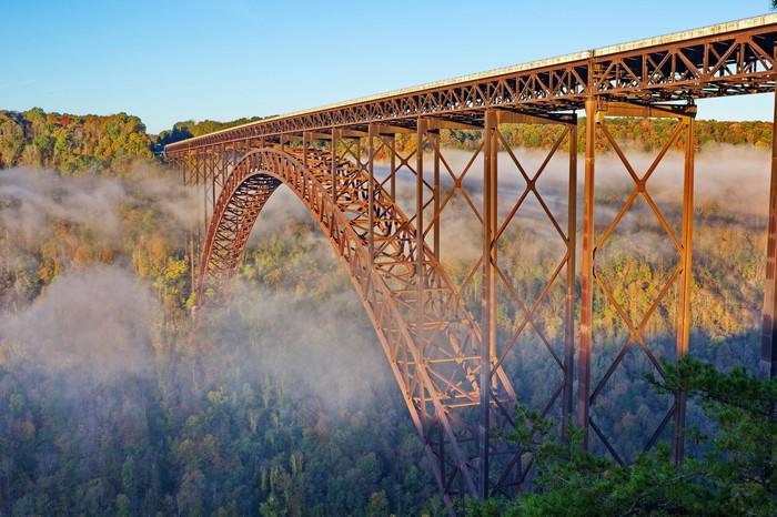 West Virginia bridge with fog beginning to lift in the morning.