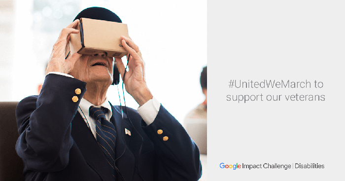 A man uses Google Cardboard virtual reality headset to view the Veterans Day Parade.