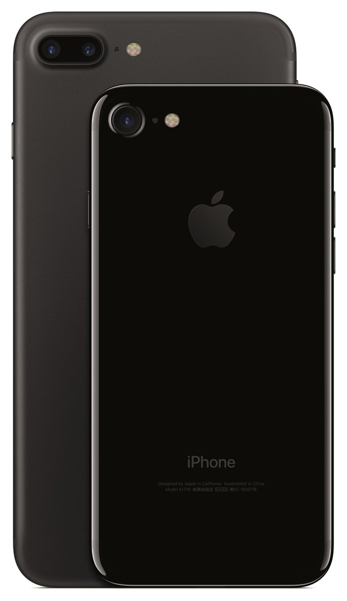 Apple's iPhone 7 Plus in gray at the back, with the iPhone 7 in Jet Black in the forefront.