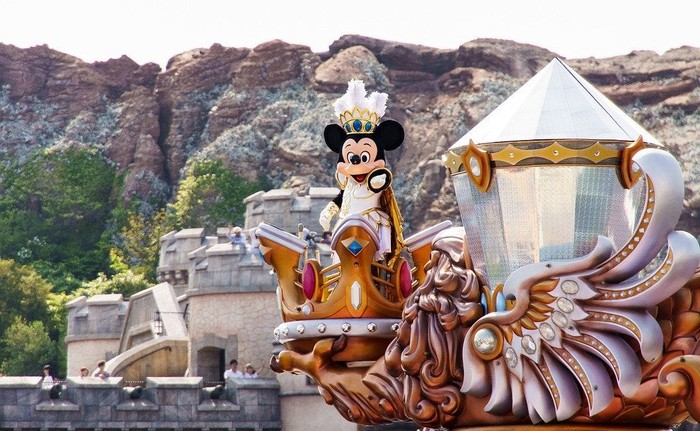 Mickey Mouse rides atop a float.