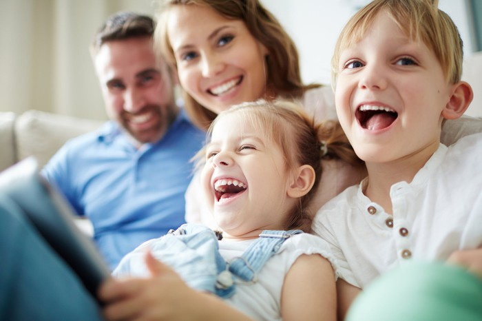 Parents with two kids laughing