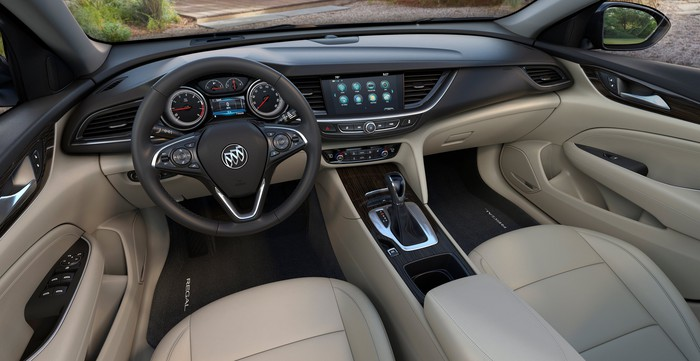 The front seat and dash of a new Buick Regal are shown.