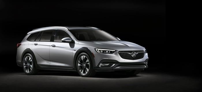 The Regal TourX, a rugged-looking wagon, is shown against a dark background.