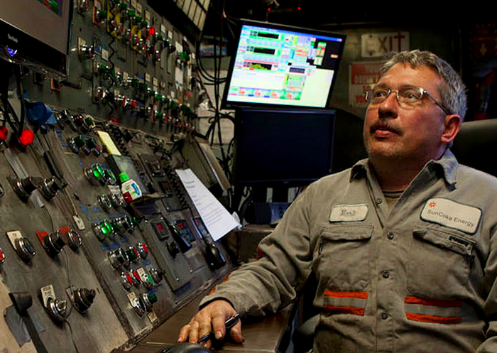 A SunCoke Energy employee at a control panel