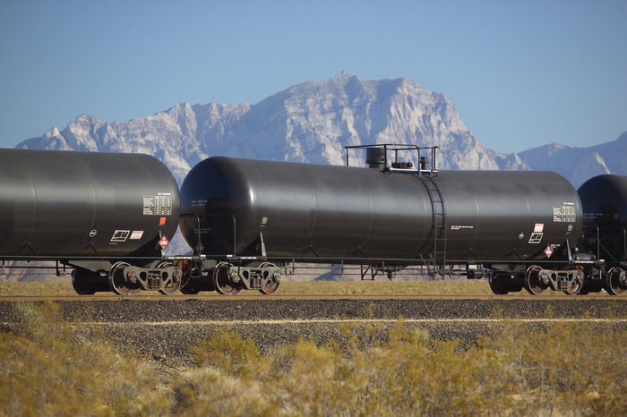 Tank car with mountain backdrop.