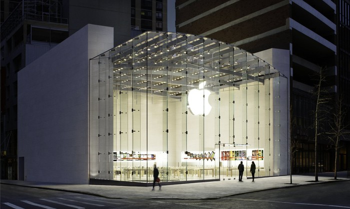 An Apple Store at night.