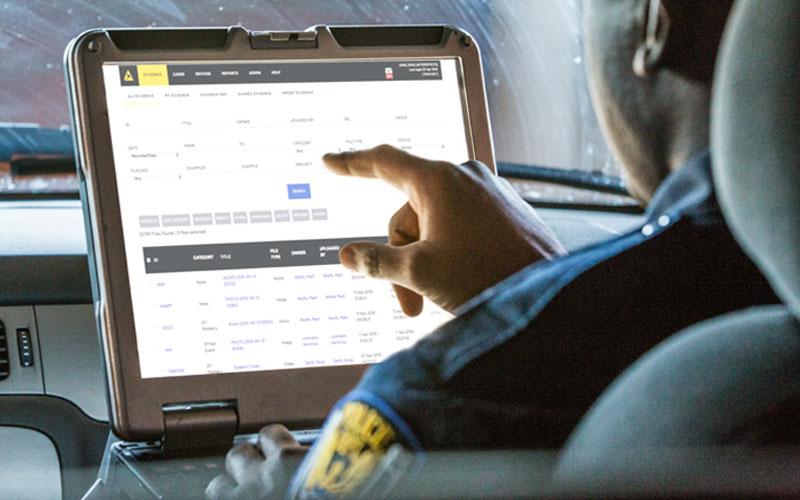 Police officer entering evidence using Axon Enterprise's Evidence.com evidence management system.