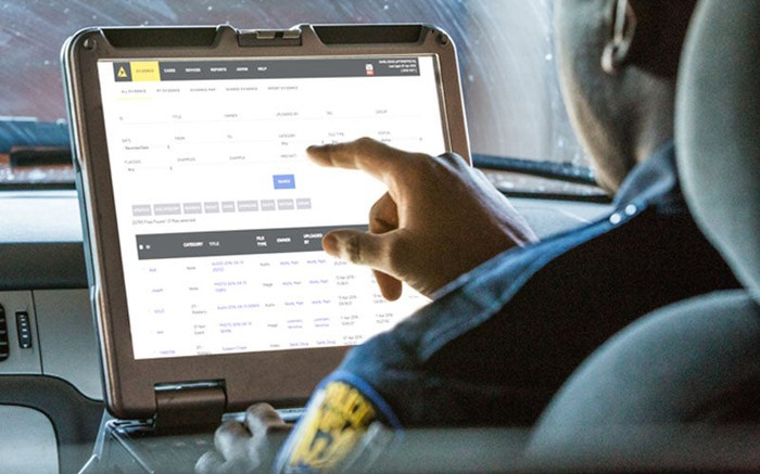 Police officer entering evidence using Axon Enterprise's Evidence.com evidence management system.