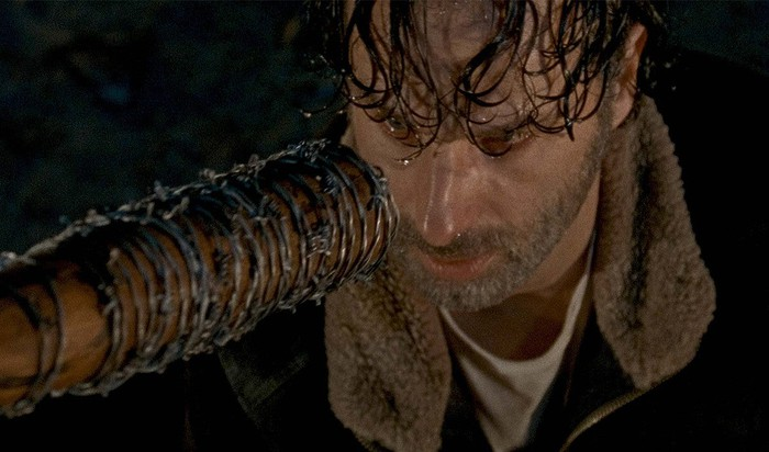 Rick Grimes, as played by Andrew Lincoln, staring down Lucille at the end of The Walking Dead's season 6.