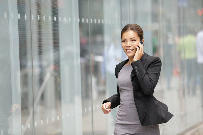 Businesswoman smiling and talking on the phone.