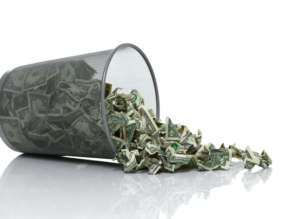 Getty Trash Can Spilling Money