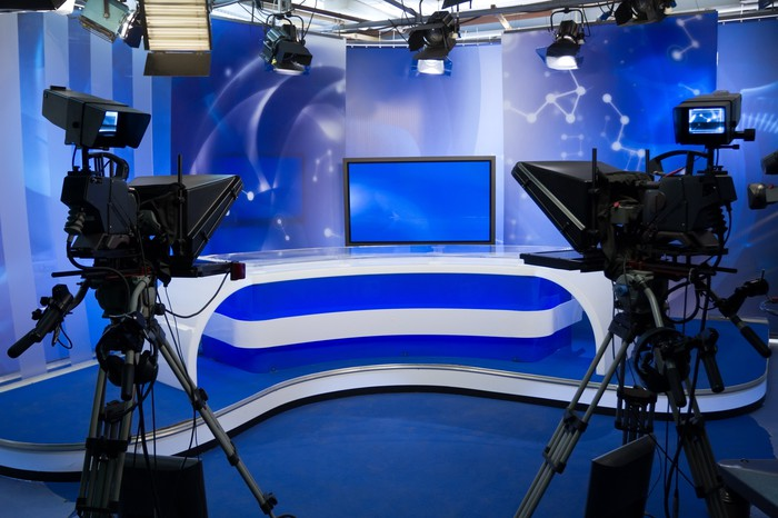 TV studio with camera and lights.