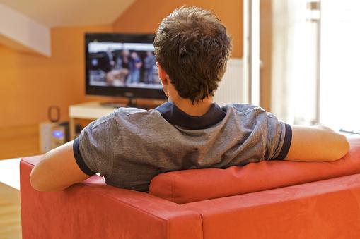 Man watching TV.