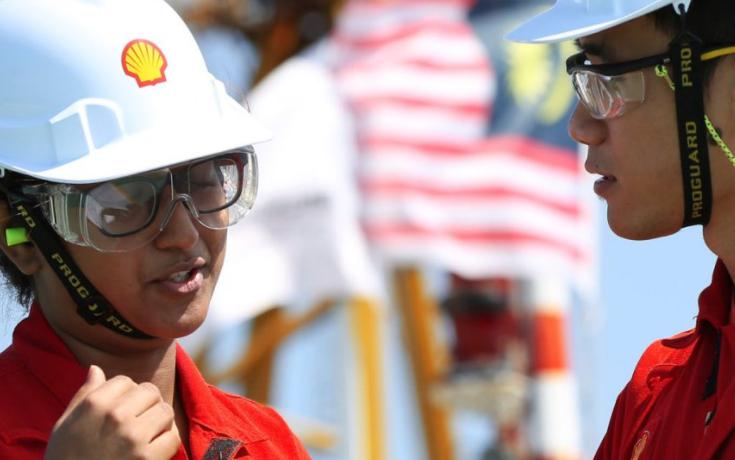 Royal Dutch Shell employees talking.