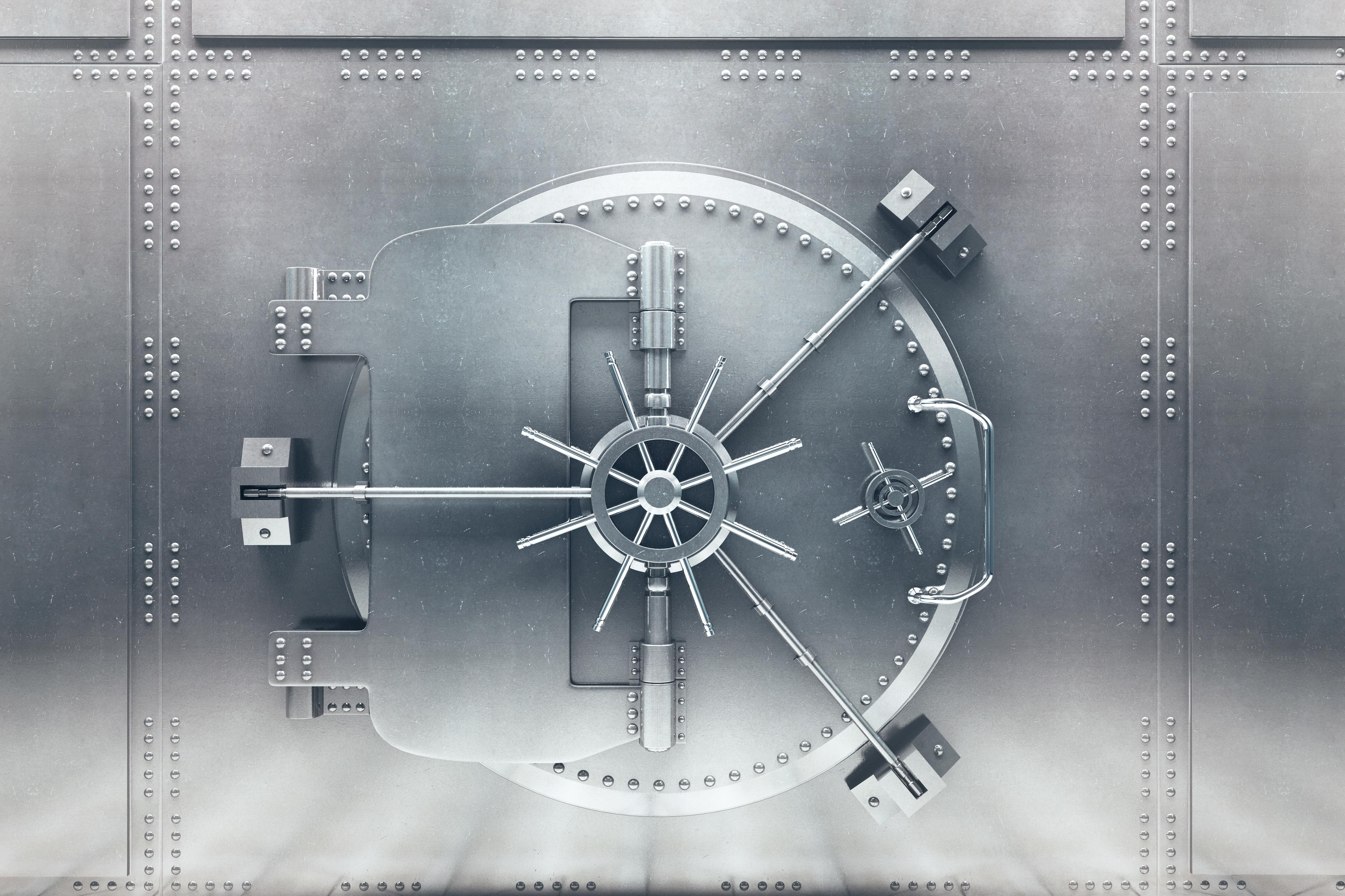 The closed door of a bank vault.