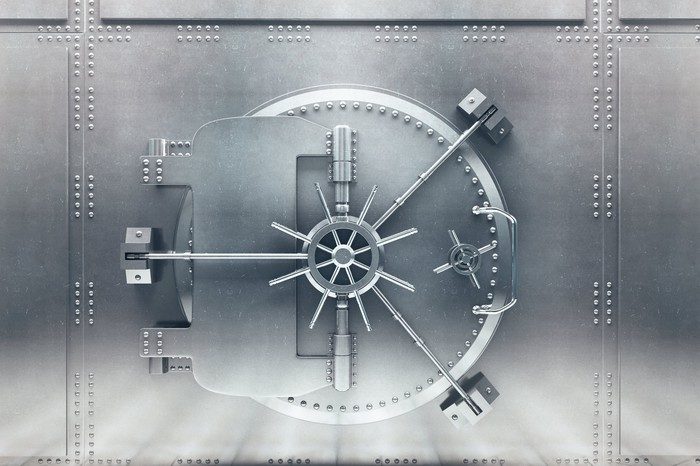 The closed door of a bank vault.