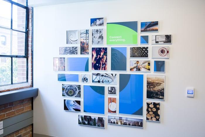 Photo collage forming Okta's circular logo