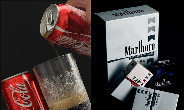 Two cans of Coca-Cola (L) and a few cartons of Marlboro cigarettes (R).