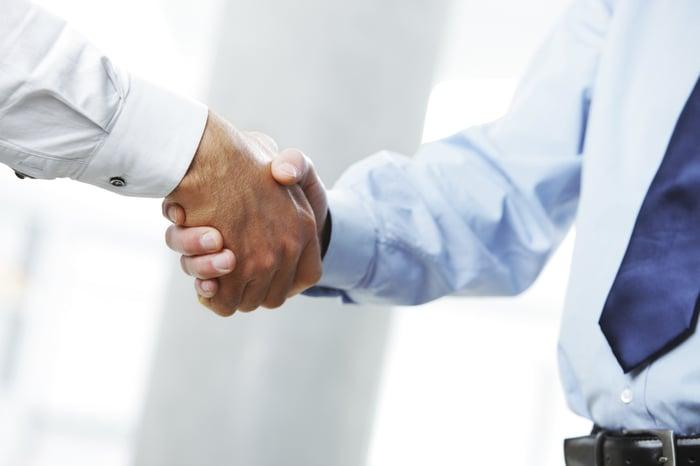 Men shaking hands.