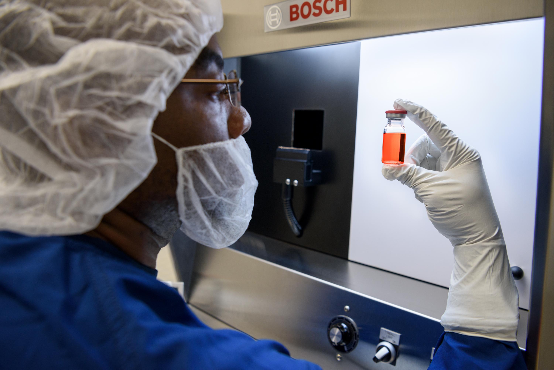 Scientist holding bottle of Glybera