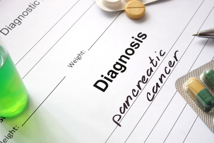 """Paper with """"Diagnosis: pancreatic cancer"""" written on it"""