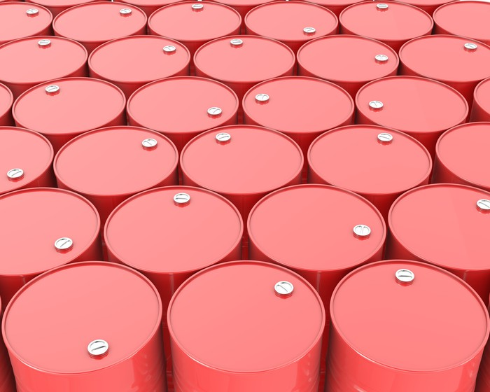 Rows of red oil barrels