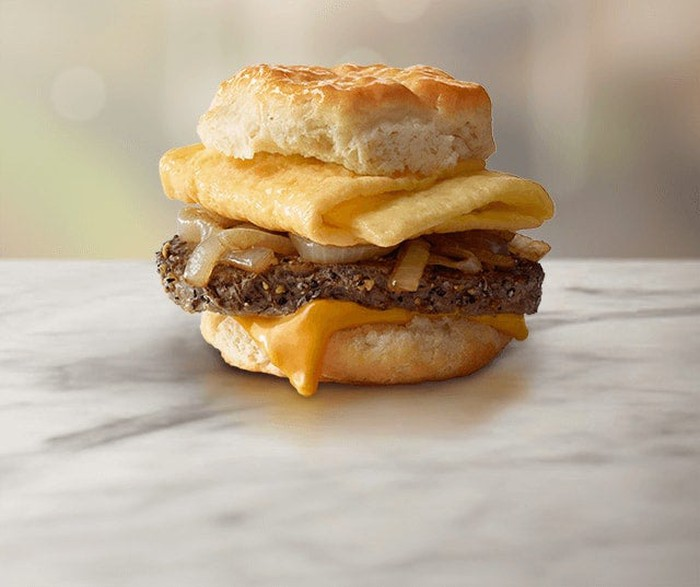 A McDonald's steak, egg, and biscuit breakfast sandwich