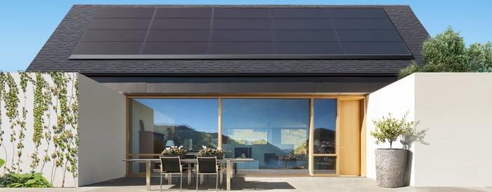 A house showcasing Tesla's solar panel design.