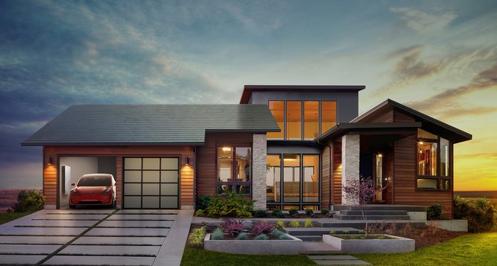 Mockup of a house with a solar roof, Powerwall, and Model 3.