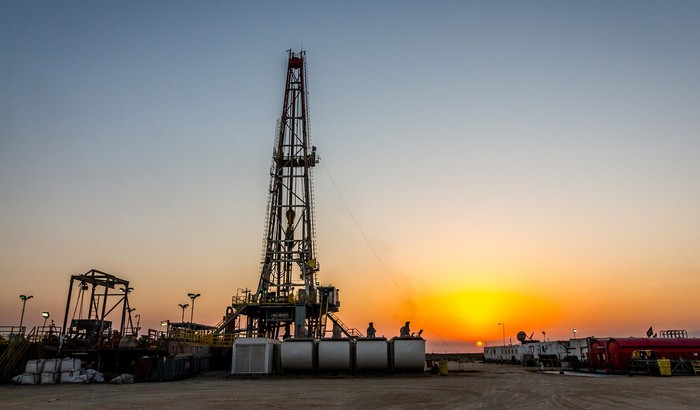 Drilling rig operating at sunset.