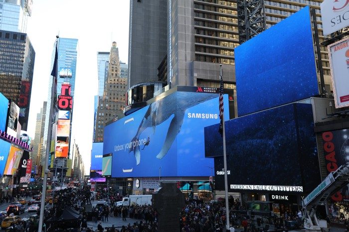 Samsung's logo displayed on large video screens outside of its recent Galaxy S8 release event