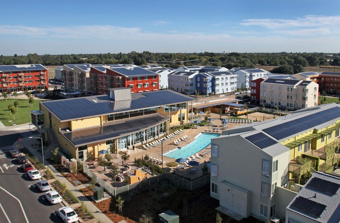 Solar panels on the roof of a college residence community in California.