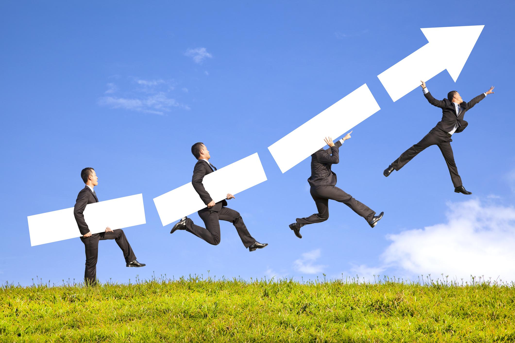 businessman riding virtual arrow up to the sky