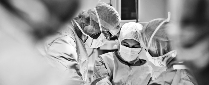 Surgeons at work in an operating room