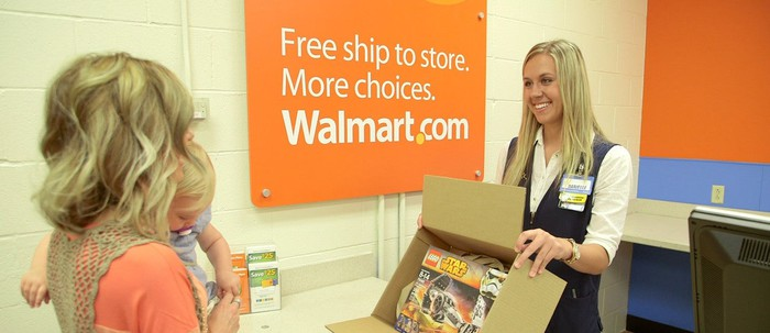 A woman picking up an online order in a Wal-Mart store.