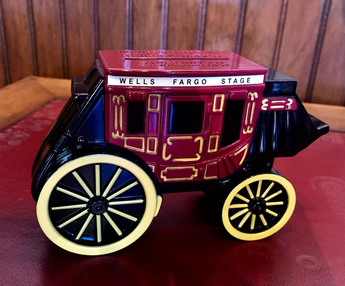 Toy stagecoach with Wells Fargo name.