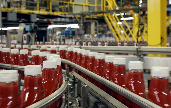 A Heinz ketchup manufacturing line is in full operation.