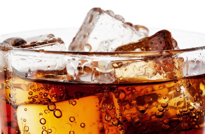 Close-up of a soft drink with ice cubes.