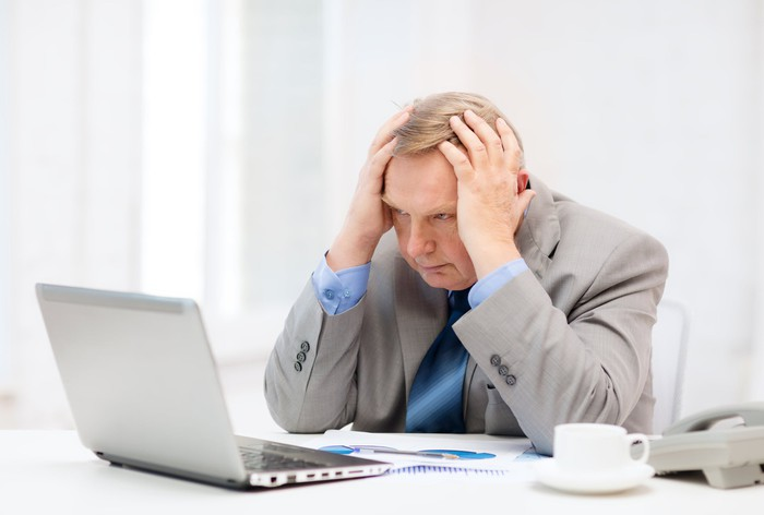 Stressed out man at his computer
