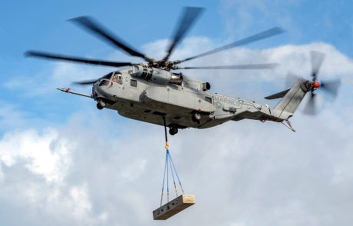 CH-53K helicopter lifting supply pallet.