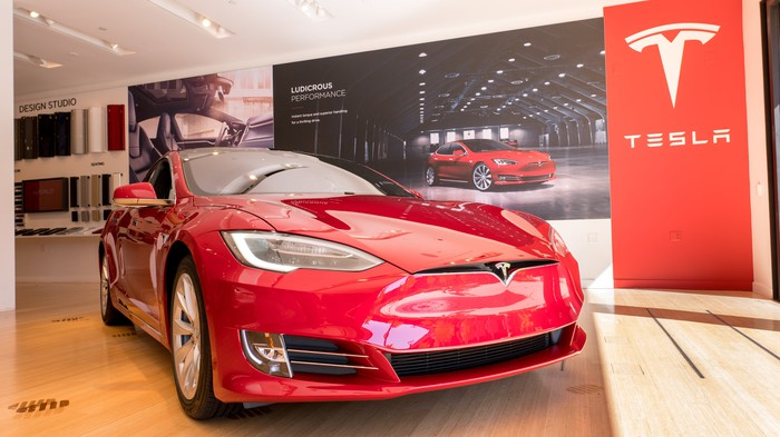 Red Model S in a Tesla store.