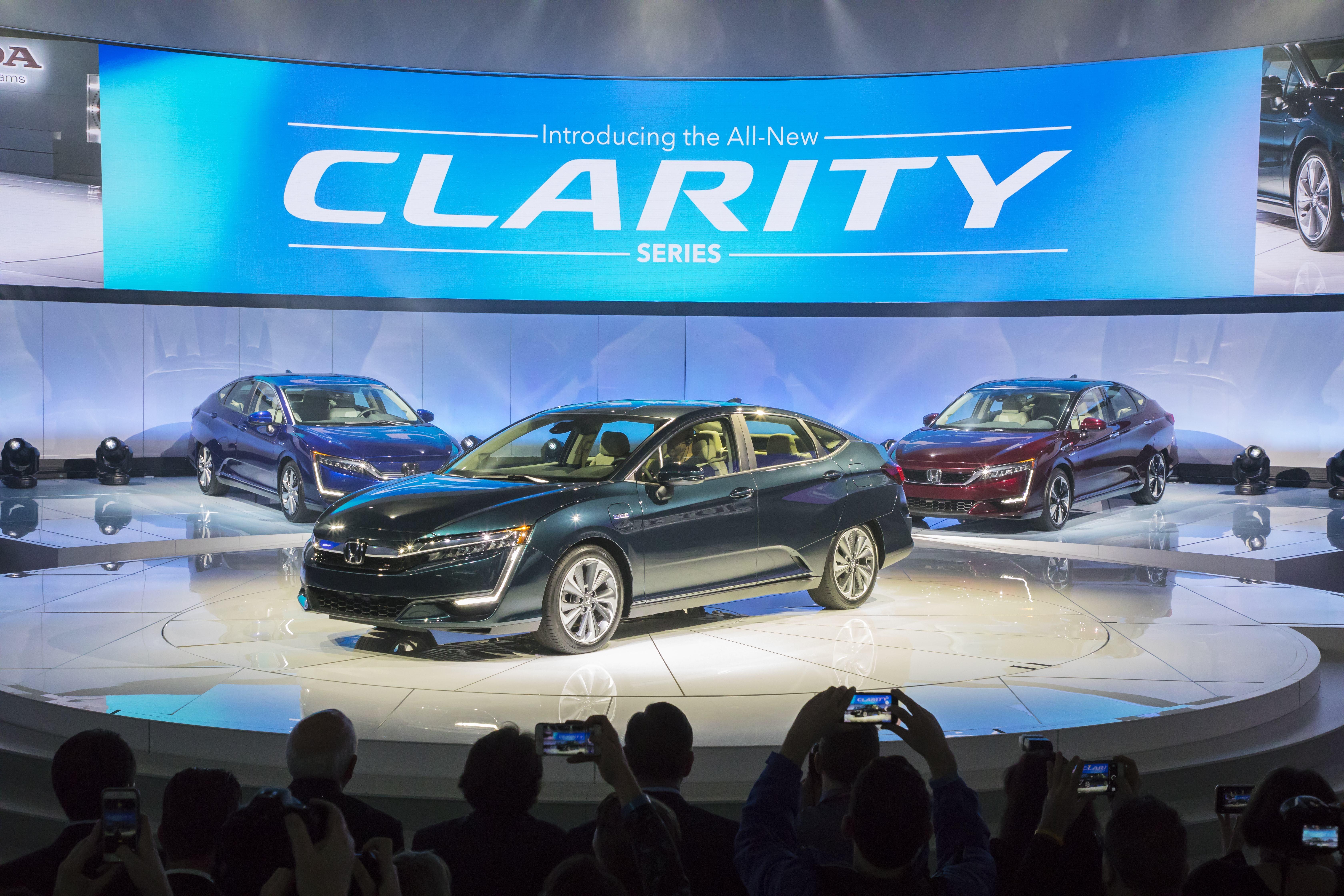 The 3 Honda Clarity sedans on display at the New York International Auto Show.