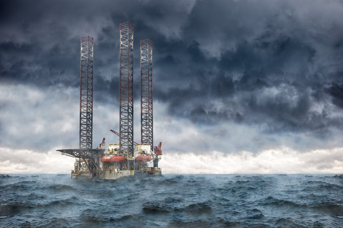 Oil rig under a stormy sky.
