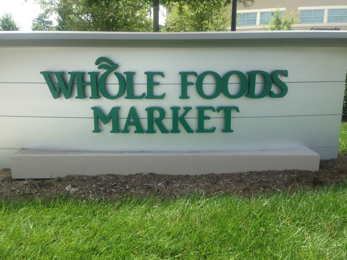 A sign at the entrance to a Whole Foods Market