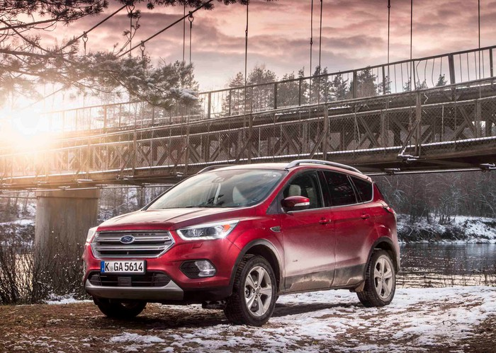 A red Ford Kuga SUV.