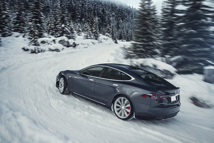 Tesla Model S driving in snow