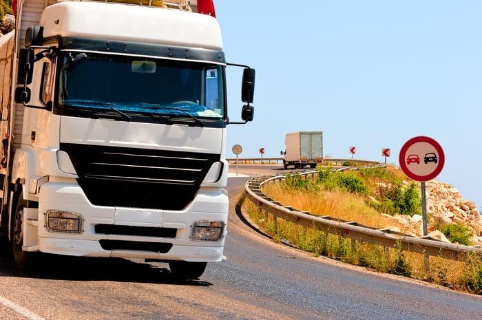 Semi truck driving downhill.